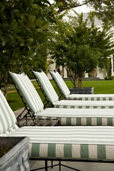 Striped patio furniture from a Brentwood regency estate designed by Elizabeth Dinkel Design Associates, Inc. Outdoor Rooms, Outdoor Gardens, Outdoor Chairs, Outdoor Living, Outdoor Decor, Lounge Chairs, Pool Chairs, Outdoor Cushions, Dining Chairs