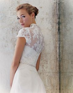 cap sleeve dress by Christos. i would like it even more if the lace could be removed for the reception!