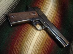Colt 1911 commercial model (NOT an A1) made in 1919, reblued but a keeper.