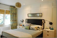 love the curtains, light fixture, picture above the bed...