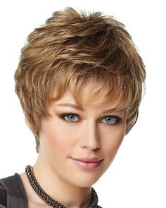 All over layered waves highlight this short textured pixie cut with a monofilament crown for a natural contour. PLEASE NOTE: COLOR AVAILABLE IS DARK COPPER. T