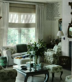 bowood chintz print mixed with white sofas, dark wood and green accents - Justine Cushing design ~Southampton home