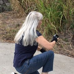 I love my long silver hair. I never considered dyeing it but I had light ash hair to begin with. The trick is to treat it gently. Using a wide toothed comb instead of a brush is this gal's best hair *do*... Shine on, sisters!