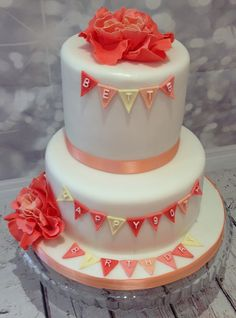 Peach coloured bunting and flowers cake for a 90th birthday