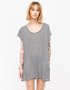 From Paris-based Margaux Lonnberg, a lightweight, loose fit tee dress with a slubby, natural text...
