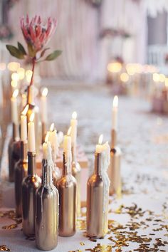 wine bottle centerpieces for wedding.like the idea of candles in them (Bottle Centerpieces) Winter Engagement Party, Engagement Parties, Engagement Ideas, Engagement Ring, Gold Bottles, Wine Bottles, Glass Bottles, Empty Bottles, Recycle Bottles