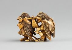 Two Tengu Carrying a Parcel, second half 19th century. Japanese. The Metropolitan Museum of Art, New York. Edward C. Moore Collection, Bequest of Edward C. Moore, 1891 (91.1.1037)