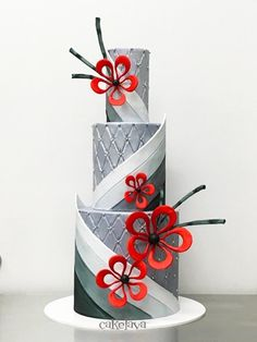 Modern wedding cake with whimiscal red flowers, designed by Rick Reichart of cakelava Las Vegas.
