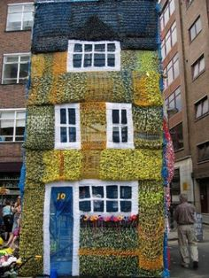 "This knitted house was made for The London Architecture Biennale by the group Knitting Site in June 2006. 3  Great Thing About This 1 . The house was knit over a 2 storey scaffolding on the site. 2. It was knitted from all recycled materials , plastic  , garbage bags and rope. The group said they really like building materials . 3 .A quote from the group "" While some people think knitting should remain behind walls , we build walls that are knitted """