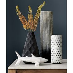 Sleek, modern vases. Designed with a minimalist aesthetic, CB2 features one-of-a-kind flower vases that are as decorative as they are functional.