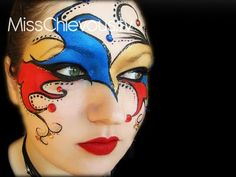 Colorful and creative jewel accented Jester themed masquerade make-up mask.