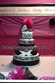 Damask baby shower cake with fondant carriage