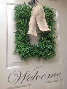 WELCOME..... My front door decorated with boxwood wreath/burlap ribbon and Welcome door decal.