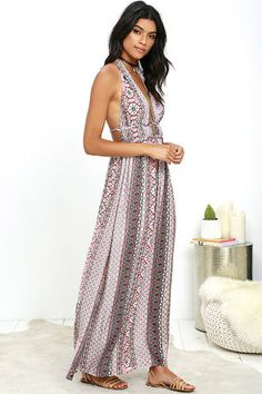 Our secret to sun-ready style is the Truth Be Told Ivory and Rust Red Print Halter Maxi Dress! Light, woven rayon has a rust red, ivory, turquoise, and black print that shapes the plunging halter bodice with low back, and braided strap (with silver clasp). More straps trim the waist above the maxi skirt. Hidden back zipper/clasp.
