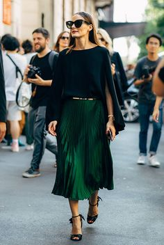 Black cape blouse, a green pleated skirt, green heeled sandals and black cat eye sunglasses. holiday outfit, holiday look, christmas outfit, new years eve outfit, fashion 2018, party outfit, #holidaystyle #partystyle #holidayoutfit #fbloggerstyle #bloggerstyle #fashionpost #holidays
