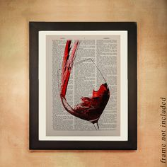 An image of red wine being poured into a wine glass, printed on a vintage page from an upcycled dictionary...