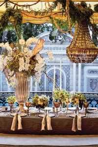 White flowers in stunning silver vase, metallic accents, shell chandelier