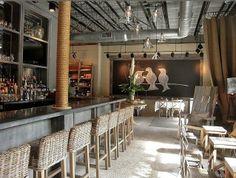 Wren restaurant.  Rope covered column, burlap draperies, blackboard wall.