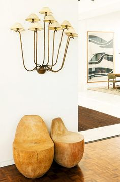Metal lamp shade wall lighting with wood stump seating.