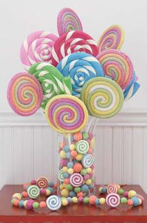 Candy Table Centerpieces | Use over-sized lollipops to create a delicious centerpiece - add candy ...