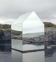Designed by the sculptor Ekkehard Altenburger, this tiny, reflective house floats in the water on the coast of Scotland's Isle of Tiree. Mirrors cover every surface of the facade, reflecting the natural beauty of its surroundings.