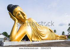 Reclining Buddha gold statue at Phuket, Thailand - stock photo