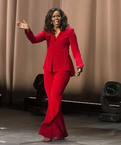 """Former first lady Michelle Obama arrives at the """"Becoming: An Intimate Conversation with Michelle Obama"""" event at the Wells Fargo Center on Thursday, Nov. in Philadelphia. (Photo by Owen Sweeney/Invision/AP) Michelle E Barack Obama, Michelle Obama Fashion, Suit Up, Red Suit, Reese Witherspoon, American First Ladies, American Women, American History, Native American"""