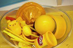 Yellow sensory bin [tot school - 18 months] she has tot trays starting at 15 mons