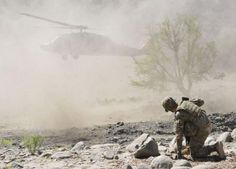 A member of Company B, Task Force 2-28, 172nd Infantry Brigade, braces against the prop wash from a UH-60 Black Hawk while securing the landing zone in a stream bed by the small village of Derka near Combat Outpost Zerok, Sept. 20. The UH-60 Black Hawk was carrying Brig. Gen. Gary Volesky, 1st Cavalry Division Deputy Commanding General, who came to observe TF 2-28's joint mission with the Afghan National Army and the local Afghan Uniformed Police to clear the village and disrupt insurgent…