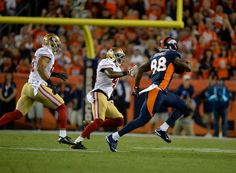 Demaryius Thomas (88) of the Denver Broncos catches a pass for a first down in the first quarter. The Denver Broncos played the San Francisco 49ers at Sports Authority Field at Mile High in Denver on October 19, 2014. (Photo by AAron Ontiveroz/The Denver Post)-- #ProFootballDenverBroncos