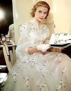 Grace Kelly on the set of ' High Society ' c. 1956, her costumes were designed by Helen Rose who also designed her wedding dress.