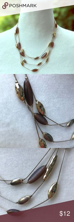"""Gold and brown bead ✨Monet✨necklace 18"""" multi-strand ✨Monet✨ necklace with gold-tone and brown/ tortoise-colored smooth, elongated beads. Some wear is seen on the gold beads as shown. Overall good condition. Offers welcome. Monet Jewelry Necklaces"""