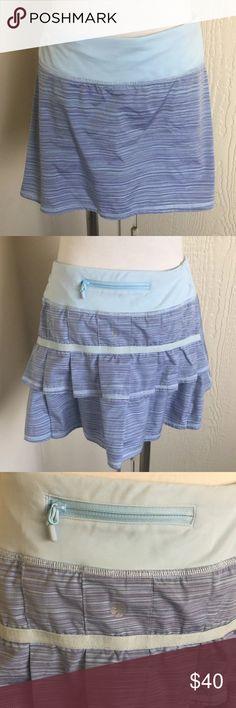 Lululemon purple striped pace setter skort Purple striped pace setter skort. Shorts underneath. Zippered pocket on back. Ruffly butt lululemon athletica Skirts