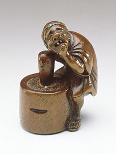 Jobun (Japan) Losing a Tooth while Pounding Rice, late 18th-early 19th century Netsuke, Boxwood with inlays
