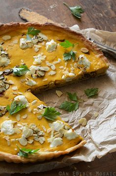 We love using pumpkin for savory dishes like this Savory Pumpkin, Ricotta, and Caramelized Onion Tart with Goat Cheese from @AnEdibleMosaic Great idea for Meatless Monday!
