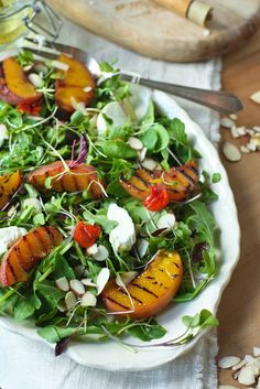 Grilled Peach Salad with Arugula, Almonds, Goat Cheese and a White Balsamic Vinaigrette.