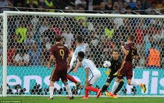 Akinfeev (second right) collects the ball to alleviate the pressure after England centre back Cahill (second left) fired an effort goalwards