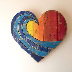 ***JUST REDUCED FROM $150 , NOW $129** NOW A 2-3 WEEK WAIT FOR DELIVERY ON THESE***   Our Rainbow Wave heart measures 20 x 20 and is made from 100% reclaimed wood. Each wood board is chosen for texture and grain, then hand cut and painted with our own hand mixed colors. The heart is assembled with 20-30 hand cut pieces and secured with both wood glue and nails, with cross braces on the back which makes it very sturdy. We finish the heart with coats of varnish to bring out the wood tones as…
