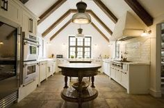 I really like the timber work on the ceiling and the wood accent tables in the kitchen.