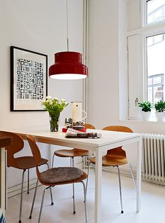 White dining room. Swedish. Love the white floors.