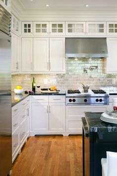 LDa Architects - kitchens - Benjamin Moore - navajo White - Tile Showcase Glass Tiles, gray, glazed, subway, glass tiles, backsplash, white, shaker, kitchen cabinets, molding, pietra cardosa, granite, countertops, black, stained, kitchen island, pot filler, Wolfe Range,