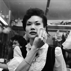 A chorus girl at the Forbidden City nightclub adds the finishing touches to her makeup. 31 Beautiful Photos Of Life In San Francisco's Chinatown In The '50s