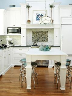 Modern stools under a floating island. via Kitchen Stools: Centasational Style