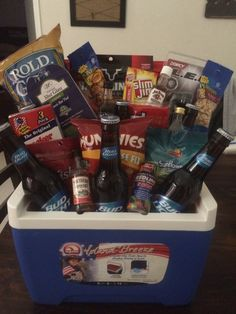 Fundraiser Gift Basket: Ice Chest, beer, trail mix, beef jerky, twizzlers, tiny bottles alcohol, shot glass, flashlight, munchies, peanuts, sunflower seeds, pretzels, cracker jacks. Complete Snack Basket