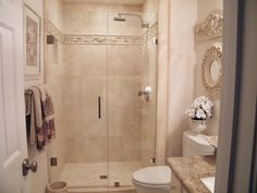 A Wilkinson team member helped select the Danze shower fixtures and Toto toilet for a half bath remodeling project