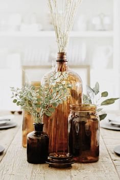 Amber bottles Fall decor using amber glass bottles Fall Home Decor, Autumn Home, Seasonal Decor, Holiday Decor, Amber Glass Bottles, Brown Bottles, Deco Floral, The Design Files, Diy Décoration