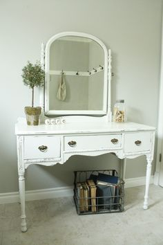 Great revamp on this cute little vanity! And I am diggin the vintage basket below!     via Life in the Fun Lane