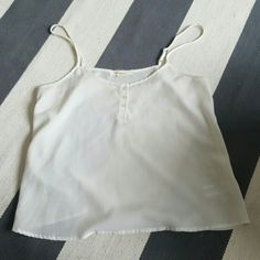 Forever 21 small ivory tank Few small smudges on front Forever 21 Tops Tank Tops