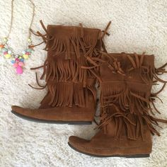 Minnetonka boots Gorgeous brown Minnetonka boots. They have three layers of fringe. They go to about mid calf. Padded insole. Rubber sole. Soft suede leather. They have been worn several times but are still in great condition. Size 7. Minnetonka Shoes