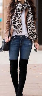women's brown jacket, animal-printed scarf, and blue-washed jeans Source